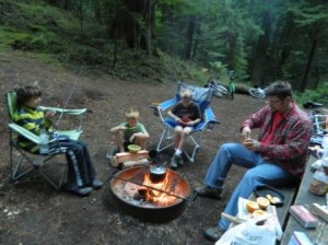 Eating muffins made inside orange peels in the coals of our fire at our first campsite.